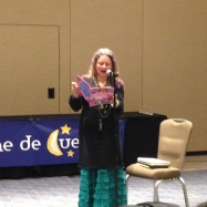 Maya Christina Gonzalez reading MY COLORS, MY WORLD/MIS COLORES, MI MUNDO during Noche de Cuentos