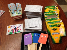 Mini-murals, markers, story time props, and Día bookmarks.